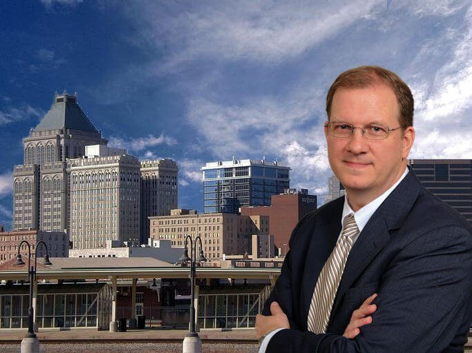 Greensboro Criminal Attorney in front of city background